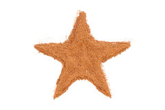 Cinnamon isolated in star shape on white Royalty Free Stock Photo