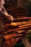 Cinnamon and laotian senior women hands at the local market in morning light. Pakse, Champasak, Laos. Warm tone. Beautiful light. Shallow dept of field. Food stock photography