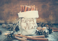 Cinnamon in a linen Bag with Embroidery Happy New Stock Photos