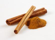 Cinnamon macro. Cinnamon close up on white bacground royalty free stock images