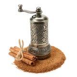Cinnamon and manual grinder Stock Photos