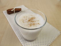 Cinnamon milk with milk foam Stock Images