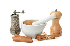 Cinnamon, mortar and pestle, hand grinder Royalty Free Stock Image