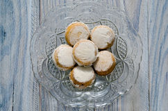 Cinnamon Muffins. Cinnamon buns in an old glass tray on a wooden table Stock Photo