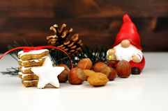 Cinnamon and nuts. Christmas still life with cinnamon, nuts and decoration Royalty Free Stock Photography