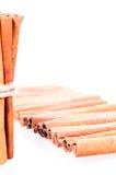 Cinnamon over white background Royalty Free Stock Photos