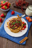 Cinnamon pancakes with chocolate sauce and berries Royalty Free Stock Images