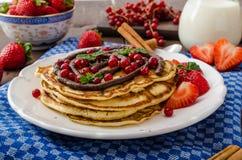 Cinnamon pancakes with chocolate sauce and berries Stock Photos