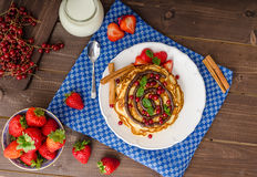 Cinnamon pancakes with chocolate sauce and berries Royalty Free Stock Photography