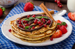 Cinnamon pancakes with chocolate sauce and berries Stock Images