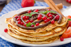Cinnamon pancakes with chocolate sauce and berries Stock Photography