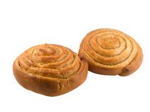 Cinnamon pastry. Two brown tasty cinnamon rolls isolated on white Stock Photos