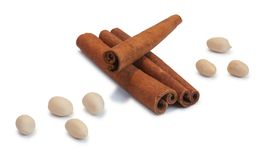 Cinnamon , peanut. Cinnamon and peanuts, a good fruit set for mulled wine or a sweet pie Royalty Free Stock Photos