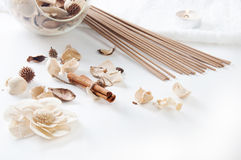 Cinnamon, perfume sticks,  aroma candle and ornamental dried flowers setting, SPA Royalty Free Stock Image