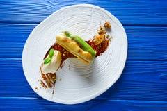 Cinnamon and pistachio cream millefeuille Stock Photos