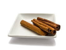 Cinnamon in plate Royalty Free Stock Images