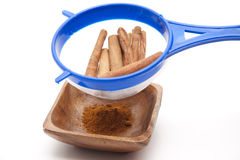 Cinnamon poles milled in the sieve Stock Photo
