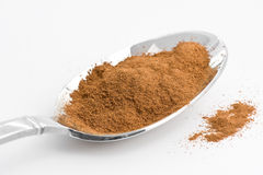Cinnamon Powder. Spoon full of cinnamon powder stock photography