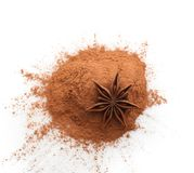 Cinnamon powder and anise star isolated on white. Top view royalty free stock image