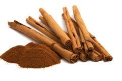 Cinnamon powder and bark stock photography