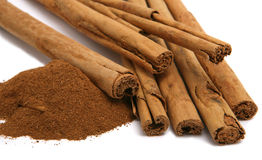 Cinnamon powder and bark Royalty Free Stock Images