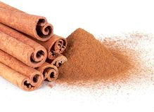 Cinnamon powder and cinnamon sticks. On a white background Stock Images