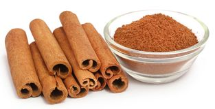 Cinnamon with powder spice. Bunch of some fresh aromatic cinnamon with powder spice Royalty Free Stock Photo