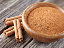 Cinnamon with powder Stock Photos