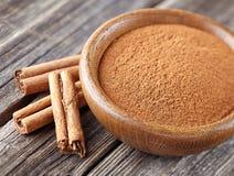 Cinnamon with powder Stock Photos