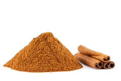 Cinnamon powder and sticks. Ground cinnamon powder and sticks on white  background Royalty Free Stock Photos