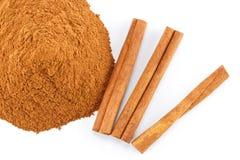 Cinnamon powder and sticks. Ground cinnamon powder and sticks on white background stock photo