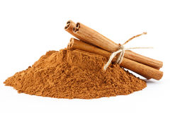 Cinnamon powder and sticks. Ground cinnamon powder and sticks on white  background Stock Photography