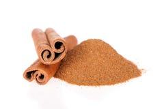 Cinnamon powder and sticks isolated stock image
