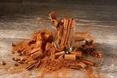 Cinnamon powder and sticks on the table Royalty Free Stock Photo