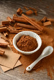 Cinnamon powder and sticks on the table Stock Photo