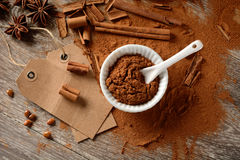 Cinnamon powder and sticks on the table Stock Photos
