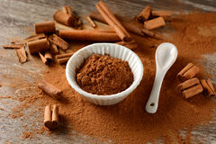 Cinnamon powder and sticks on the table Stock Photography