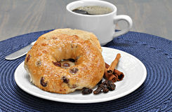 Cinnamon Raisin Bagel, buttered and toasted. Royalty Free Stock Photo