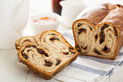Cinnamon raisin bread for breakfast. On white table with coffee Royalty Free Stock Photos