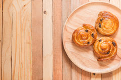 Cinnamon raisin roll bun. Top view of cinnamon raisin roll bun,still life style from above Royalty Free Stock Image