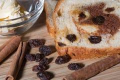 Cinnamon raisin toast with dish of butter. Close up of cinnamon raison bread with raisins and cinnamon sticks Stock Photography
