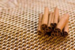 Cinnamon on rattan. Pile of cinnamon sticks shot on rattan Royalty Free Stock Image