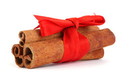 Cinnamon with red ribbon Royalty Free Stock Photography