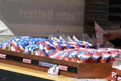 Cinnamon roasted nuts in patriotic packaging Stock Photos