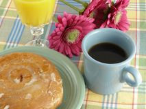 Cinnamon Roll. And a cup of coffee served on vintage Fiesta dinnerware Stock Images