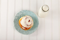 Cinnamon Roll with Cream Cheese Frosting above view Royalty Free Stock Photography