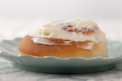 Cinnamon Roll with Cream Cheese Frosting macro shot Royalty Free Stock Photo