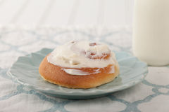 Cinnamon Roll with Cream Cheese Frosting side shot Royalty Free Stock Images