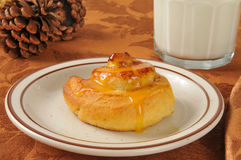 Cinnamon roll with milk Stock Images