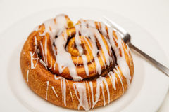 Cinnamon Roll on Plate with Fork Royalty Free Stock Images
